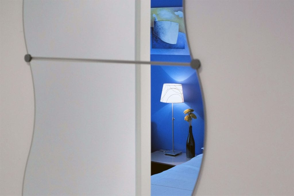 Zavala 222 B1 bedroom in the mirror