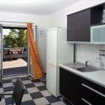 Zavala 222 B2 kitchen and the terrace